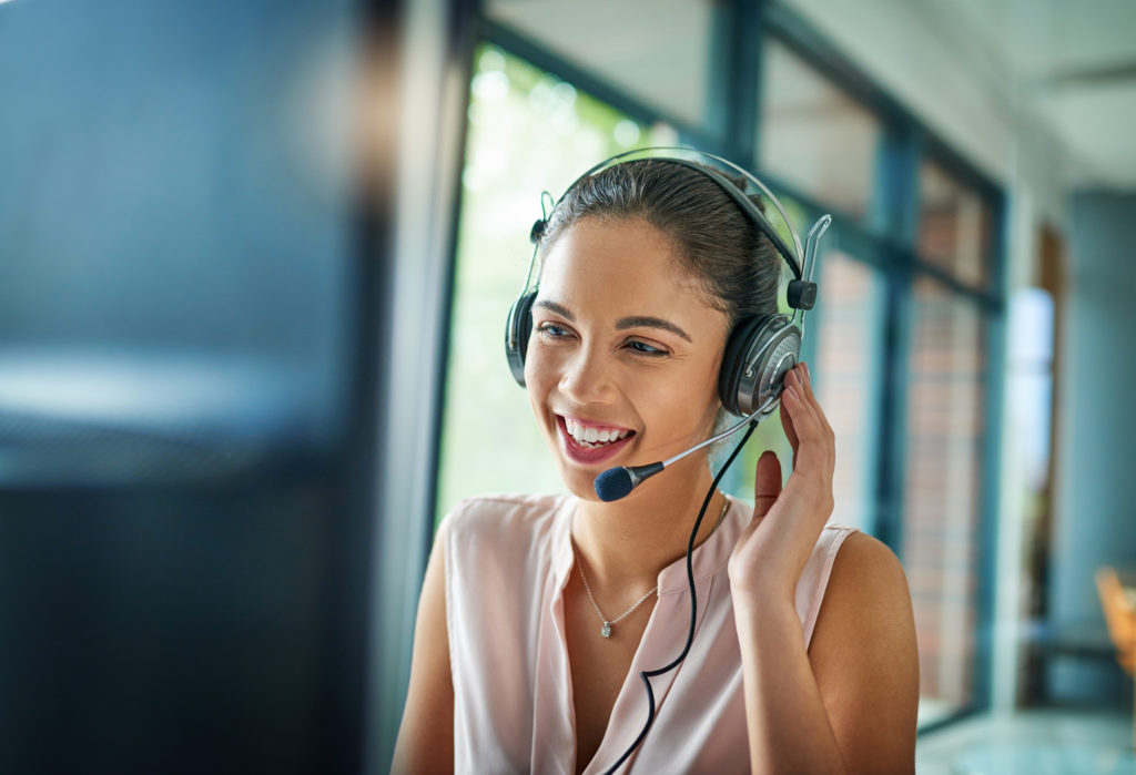 young businesswoman working customer support to convert prospects to customers